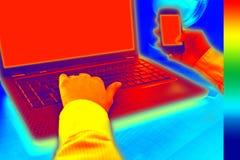 Infraröd värme för thermovisionbildvisning i kontoret Arkivbild