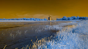 Infrared farm and lake landscape Stock Photography