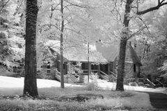 Infrared forest and cabin Royalty Free Stock Images