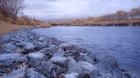 Infrared image of Manawatu river in Palmerston North New Zealand. With stone protection on its banks royalty free stock images