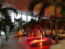 Infrared lamps and loungers. At spa resort - palm trees Royalty Free Stock Photos