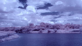 InfraRed landscape: Movement of clouds over the reservoir. Donetsk, Ukraine, Full HD stock video footage