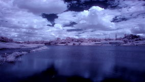 InfraRed landscape: Movement of clouds over the reservoir. Donetsk, Ukraine, Full HD stock footage