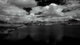 InfraRed landscape: Movement of clouds over the reservoir. Donetsk, Ukraine, Full HD. stock video footage