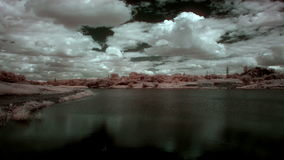 InfraRed landscape: Movement of clouds over the reservoir. Donetsk, Ukraine, Full HD. stock footage