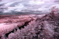 InfraRed landscape: Movement of clouds over the river Seversky D Royalty Free Stock Photography
