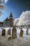 Infrared landscape of old church in churchyard in English countr Royalty Free Stock Images