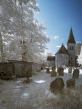 Infrared landscape of old church in churchyard in English countr Stock Images