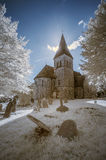 Infrared landscape of old church in churchyard in English countr Royalty Free Stock Photos