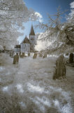 Infrared landscape of old church in churchyard in English countr Royalty Free Stock Photo