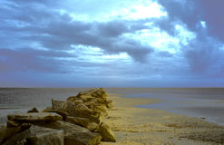 Infrared landscape of sea jetty and clouds Royalty Free Stock Image