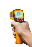 Infrared laser thermometer in hand Royalty Free Stock Photography