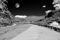 Arizona Sonora Desert Moon and road in infrared monochrome. Infrared monochrome desert full moon over the southwestern USA Sonora desert Arizona and mountain royalty free stock photography