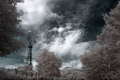 Infrared old farm windmill Stock Image