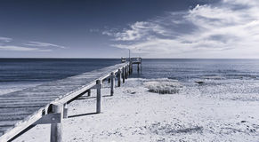 Infrared photo of dock and ocean Stock Photography