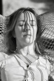 Infrared Photo of Middle Aged Woman Napping in a Hammock Stock Photo