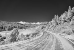 Infrared picture of a mountain road in winter royalty free stock images