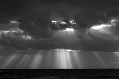 Infrared stormy sea sky with sunbeams Royalty Free Stock Photo