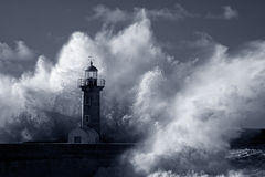 Infrared stormy waves over old lighthouse Stock Photo