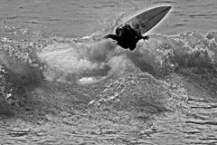 Infrared Surfer. An infrared  black and white view of a surfer cutting back on a wave Royalty Free Stock Image