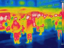 Infrared Thermal image of people at the city railway station on a cold winter day stock images