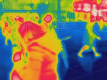 Infrared Thermal image of people walking the city streets on a cold winter day stock photography