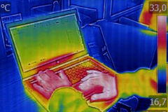 Infrared thermography image showing the heat emission Stock Images
