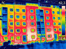 Infrared thermovision image showing lack of thermal insulation o. N Residential building royalty free stock photo