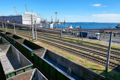 Infrastructure of industrial cargo seaport with railroad car, truck and ship, road over the bridge Royalty Free Stock Photos