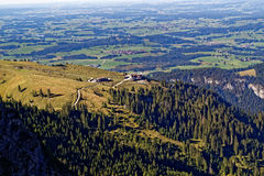 Infrastructure in mountainous region of Allgau Alps aerial. A place to rest by mountain hiking with view over the lowlands. Aerial view to the cable-car station Royalty Free Stock Photo