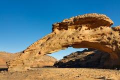 Infudha Natural Rock Arch - Akakus, Sahara, Libya. Infudha Rock Arch - Natural Rock Arch - Akakus (Acacus) Mountains, Sahara, Libya royalty free stock images