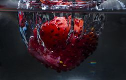 Infused detox water with blueberry, strawberry stock photo