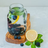 Infused detox water with lemon blackberry blueberry and mint lea stock photo