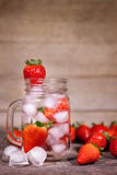 Infused or Detox Water with strawberries, selfmade lemonade. Infused or Detox Water with strawberries, fresh organic selfmade lemonade Stock Images
