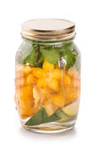 Infused fresh fruit water of mango, starfruit and mint.isolated Stock Images