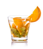 Infused fresh fruit water of orange and grape. isolated over whi Stock Photos