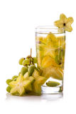 Infused fresh fruit water  starfruit and grape. isolated over wh Stock Image