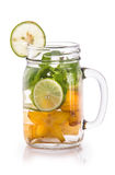 Infused fresh fruit water of starfruit, mint and lime. isolated Royalty Free Stock Photography