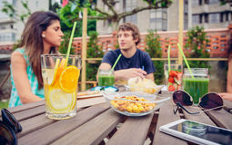 Infused fruit water cocktails and people talking Royalty Free Stock Photography