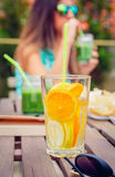 Infused fruit water cocktails and woman drinking Royalty Free Stock Image