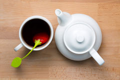 Infused Tea and Teapot. Next to each other on beech wood, shot from top royalty free stock photos