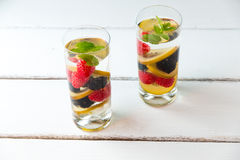 Infused water with  berries and golden kiwi. Royalty Free Stock Image
