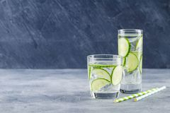 Infused water with cucumber and ice royalty free stock photo