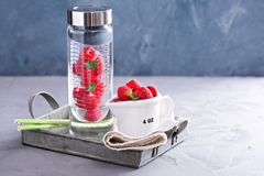 Infused water with mint and raspberries Stock Image