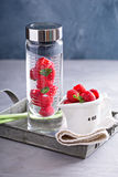 Infused water with mint and raspberries Stock Photo