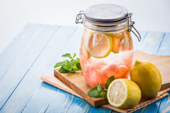 Infused water mix of lemon and grapefruit Stock Images