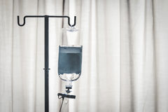 Infusion bottle with curtain Stock Images