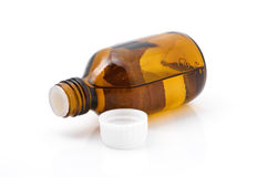 Infusion in the bubble. Brown bottle with a liquid medicine Royalty Free Stock Images