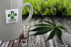 Infusion of cannabis in ceramic cup royalty free stock photo