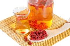 Infusion of goji berries Stock Photos